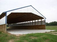 A storage structure with grass around it